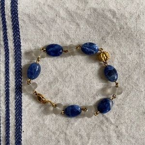 Blue and white stone bracelet with gold accents